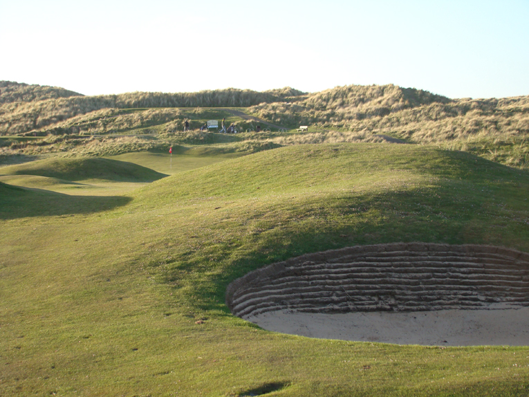 A lay-up short of this and its sister bunker to the left is oft times the intelligent play, especially since the golfer has yet to confront this wind direction. The thirteenth is the only hole that plays in a northerly direction.