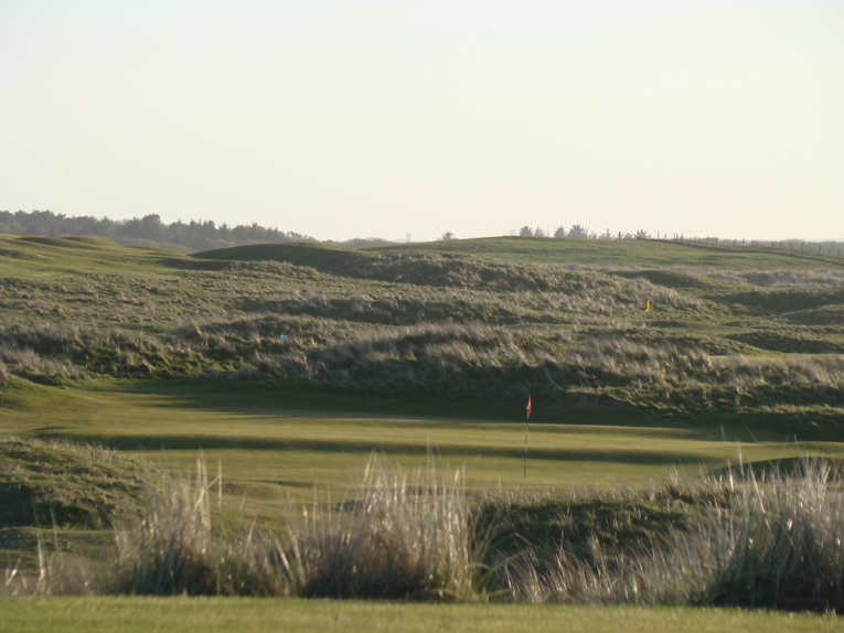 The ridges in the green are evident in this zoomed in view from the tee of the green nestled low into the dunes.