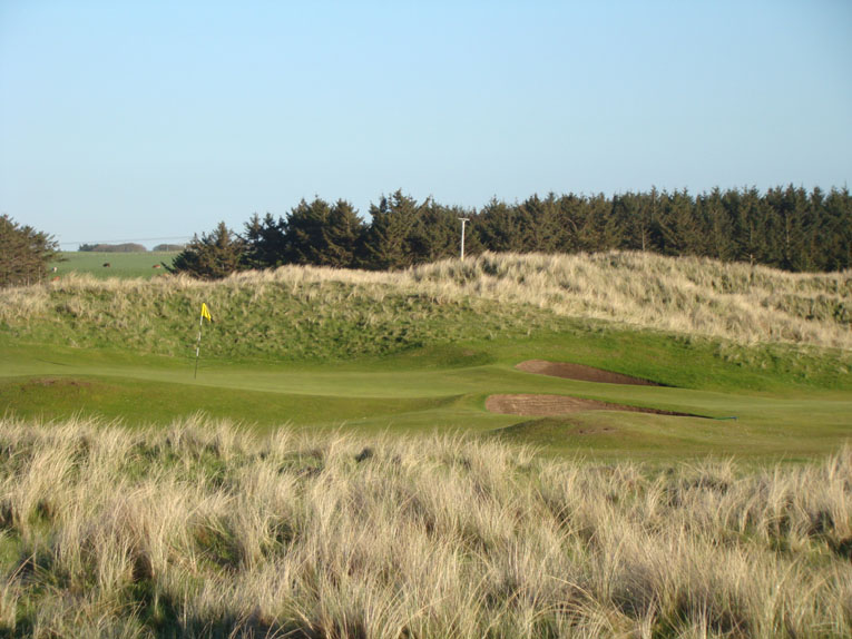 A miss right of the green gives little hope of recovery given the green's right to left slope. And yet, a recovery from the left as seen above is not headache free either courtesy of a dominant knob and steep bank.