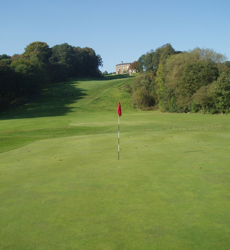 Reddish Vale is an unheralded design gem, especially for a course built by Alister MacKenzie and that features some of the most memorable holes in the game. In the foreground is the sixth green reached from 240 yards away from a tee high on the hill. The fairway that leads up to the clubhouse is the eighteenth whose steep grade is unmatched in golf.