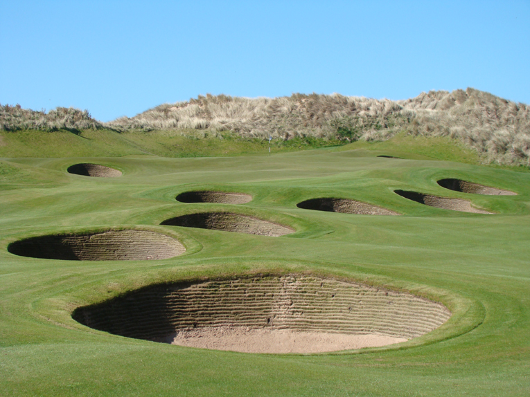 The cluster of bunkers found 20-90 yards from the green is a design theme repeated at both the first and eighteenth. Throw in playing into the wind and the third shost into all three of these par fives is likely to be longer here than what the golfer is accustomed.