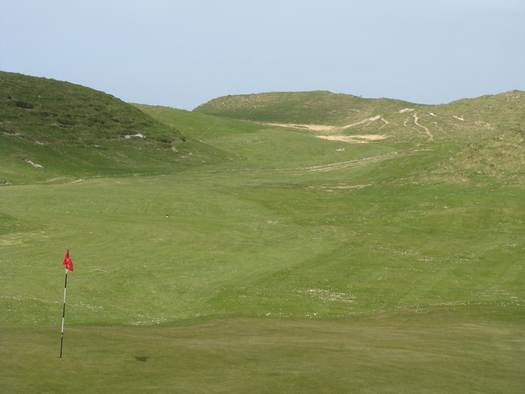 This view from the seventh green back up to the tee is a clear indication of the wild terrain that the golfer has now entered.