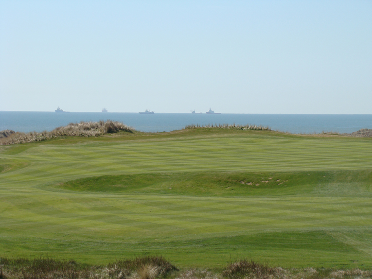 As seen from the tee, the ships remind one of Aberdeen's long distinguished history as a major port.