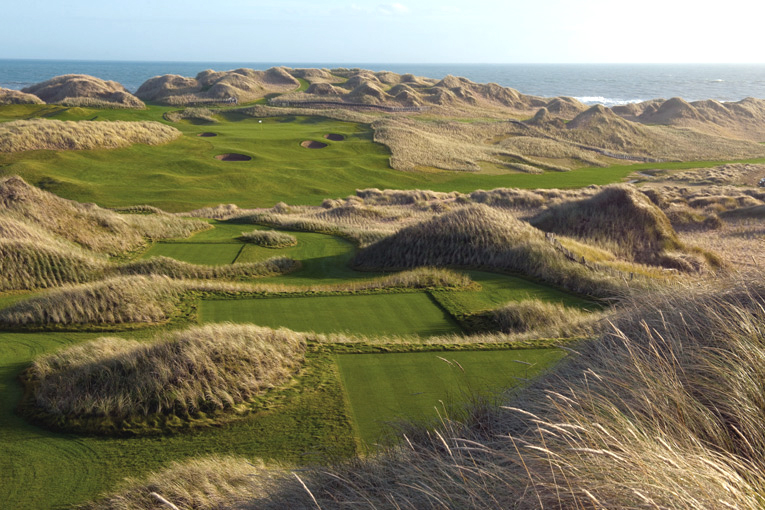 The vast spaciousness of both the dunes and the course is acutely felt from the thirteenth tee. Note how the marram grass was planted to stabilize the dune system.