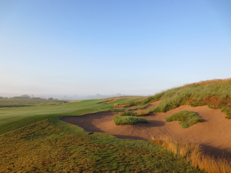 With the wetland to the left and this bunker to the right, the opening tee shot demands the player's attention. As is also the case with lay-up seconds to the fourteenth and eighteenth holes, the second shot of the opener tests a player's discipline as he needs to aim well away from the visible green.
