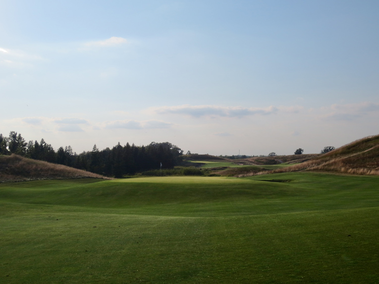A well-placed tee shot to the left affords a full view of the tint domed green for the pitch.
