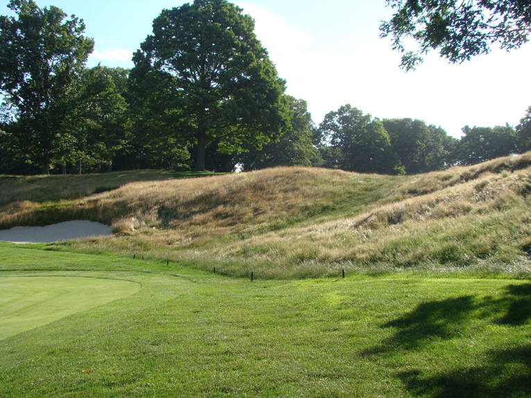 This fierce thirty foot rise falls 490 yards from the tee - getting past it in two shots is the object.