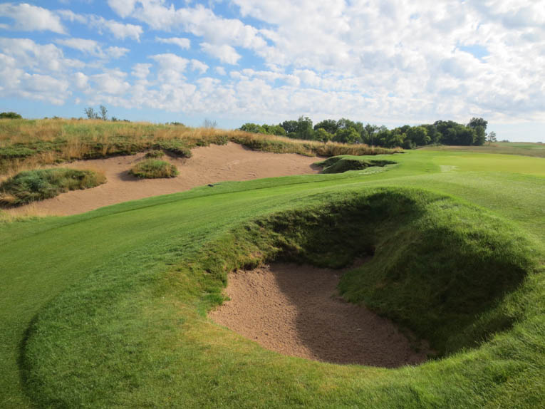 Bunkers come in all shapes and sizes at Erin Hills.  On the 13th this small pit is paired with a sprawling erosion bunker.