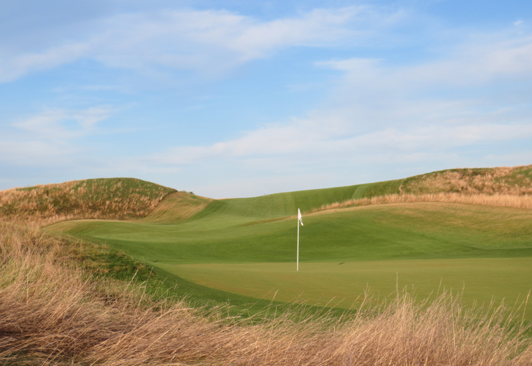Ballybunion? Cruden Bay? No, the roller-coaster twelfth at Erin Hills.