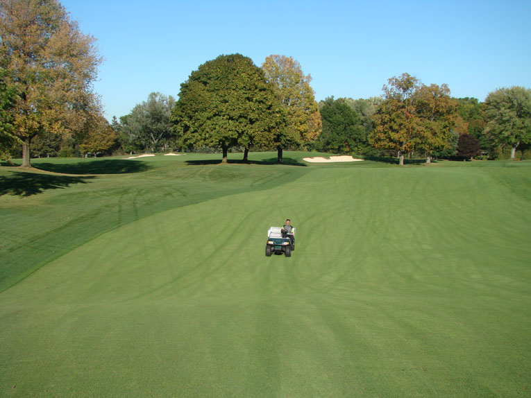 Looking back down the twelfth fairway, McMaster's cart denotes where the rough line was in 2002. This wonderful bowl is an example of a unique feature that once was lost and is now found.