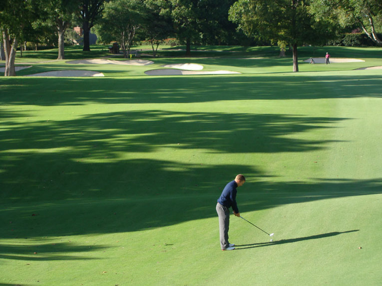 Reaching this par five in two is more complicated than one might assume. First, there is the matter of drawing a good stance in the fairway. Next, shots played from the left side of the fairway require the golfer to be mindful of the oak tree that hangs over the front left pond. In addition, the built-up green pad is only 25 yard deep, making it a tough target to hit and hold with anything other than a good strike. Landing in any of the back bunkers at Southern Hills is a dire mistake that any golfer will soon regret.