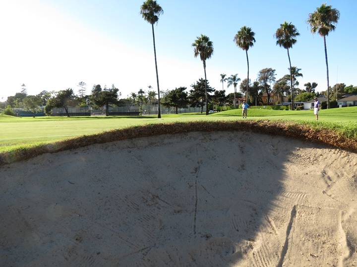No 2-D bunkers here! This view from inside the greenside bunker at the fourteenth proves that these penal bunkers add to the strategic options of each hole.