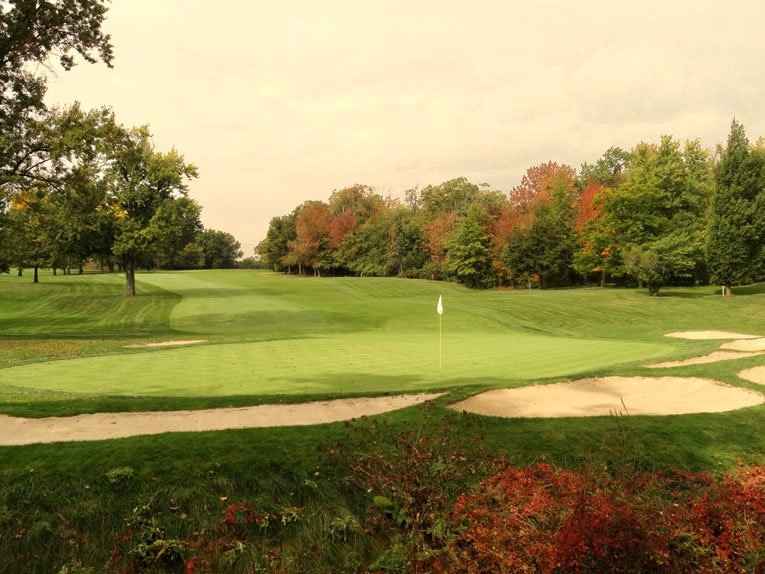 As seen from behind, balls that land as far back as forty yards can scamper onto the 13th green.