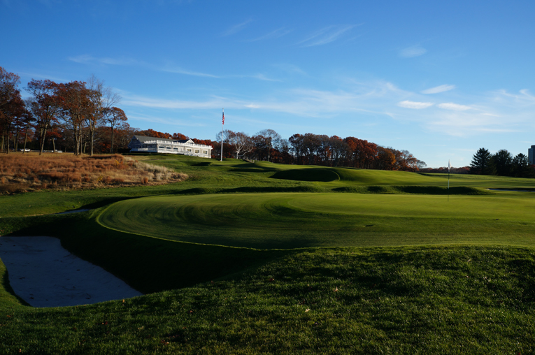 As seen from back right of the green, one readily appreciates the menace posed by the tandem of the short grass and the slopes that feed off the fifteenth green complex.
