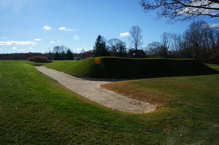 This view from back right of the green highlights Emmet's unique bunkering style as well as the volume of fill needed to create the green pad.