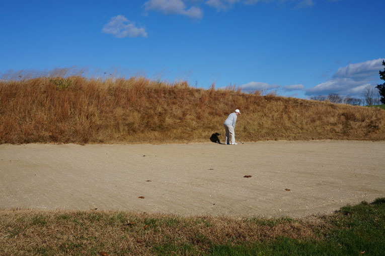 Emmet cut this nine foot deep bunker into the brow of the hill that the golfer drives over at the eighth.