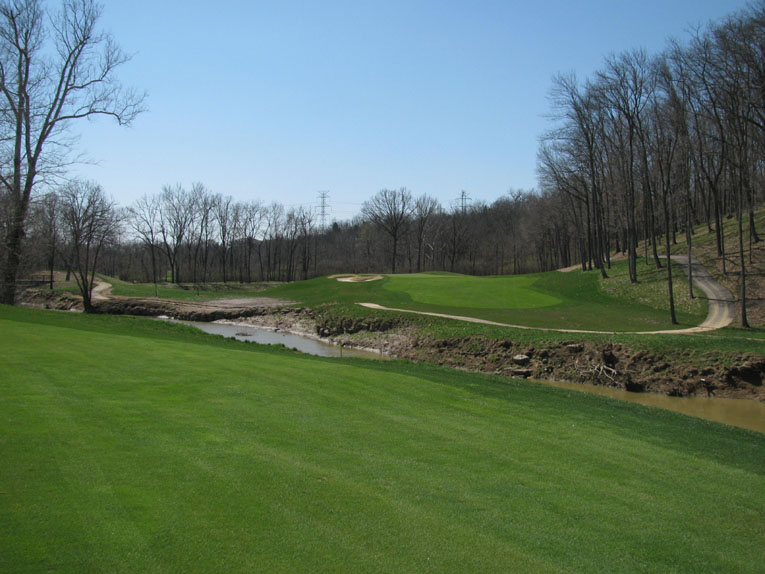 The intimidating sixth hole requires an accurate tee shot and a mid to long iron second to a green with much movement