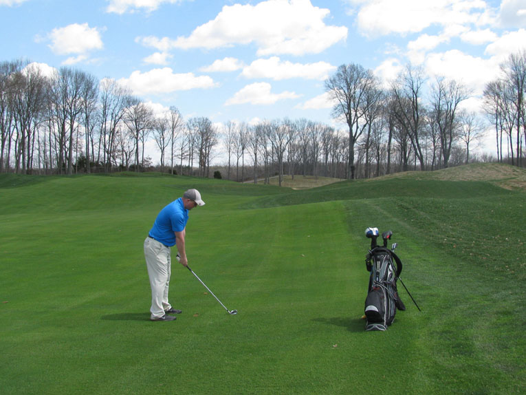 GCA's Marc Huther goes for green in two. A mostly blind shot can be fired at the left edge of the green and use the contours to feed the ball toward the middle avoiding the fronting bunker