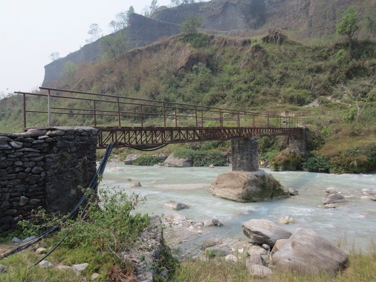 This bridge is one example why the author recommends hiking boots rather than golf shoes for a round at Himalayan Golf Course.