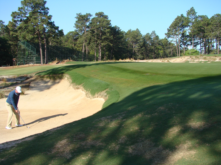 Though deep, the front left bunker affords the golfer the chance of hitting a controlled recovery shot with spin to the crowned green. His splash shot needs to carry a good thirteen paces on the putting surface or the green contours repel the ball sending it back into the very same bunker. The horror of a ball returning to one's feet makes No.2 such a nerve jangling course to play in a 72 stroke event.