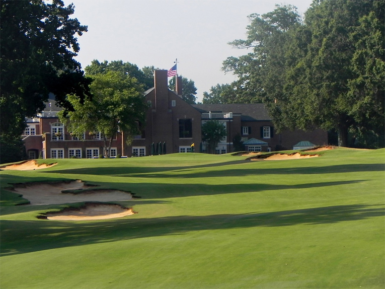 The red brick clubhouse is the design of noted New York architect Aymar Embury II and serves the club well. Harold Macklin was the Associate Architect and his institutional work transformed downtown Winston-Salem before he passed away here in 1964.