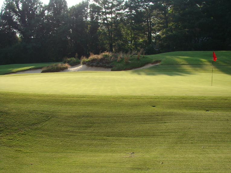 By 2000, the fifth green had morphed from subtle rolls to distinct tiers, a most un-Maxwell feature. Dave Axland worked and worked - and worked - to  restore Maxwell's puffs on the putting surface with great success, as seen above in this view from the right side.