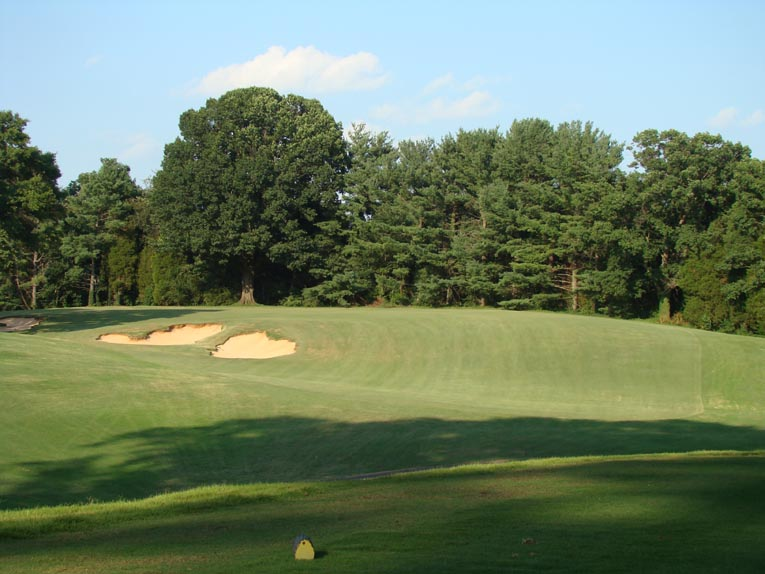 The three staggered bunkers beautifully draw the golfer's eye down the memorable fifth.