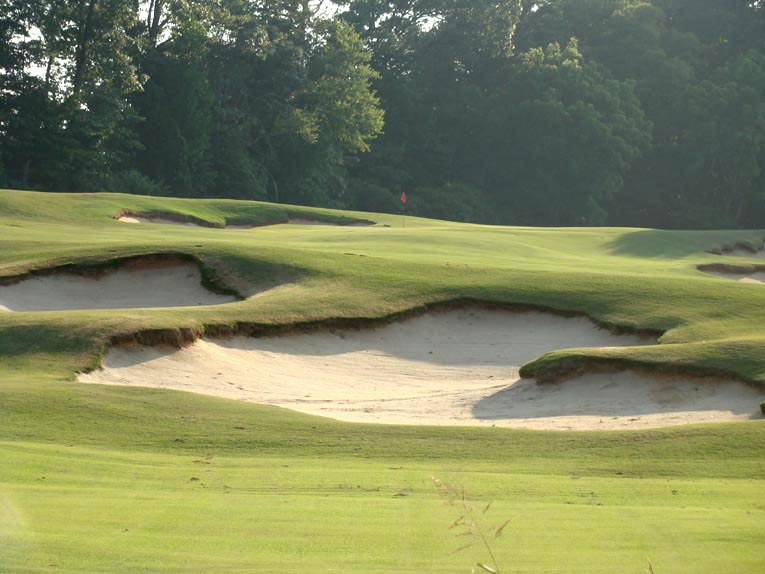 Golden Age architects excelled at cutting bunkers into natural upslopes. So too do Coore & Crenshaw!