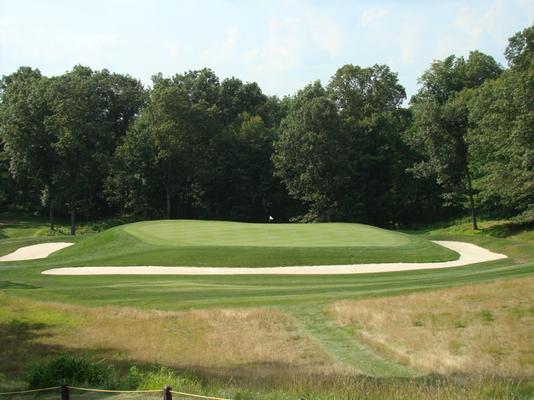 The Short hole restored to its former glory. The pronounced indentation in the middle of the green can be discerned from the tee and is the source of many a three-putt bogey.