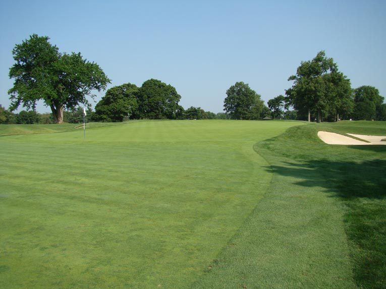 The first green starts at grade with the fairway before rising nearly six feet toward the back. Yet, it steps up so slowly, so gracefully that the first time golfer is frequently deceived by the green's wicked qualities.