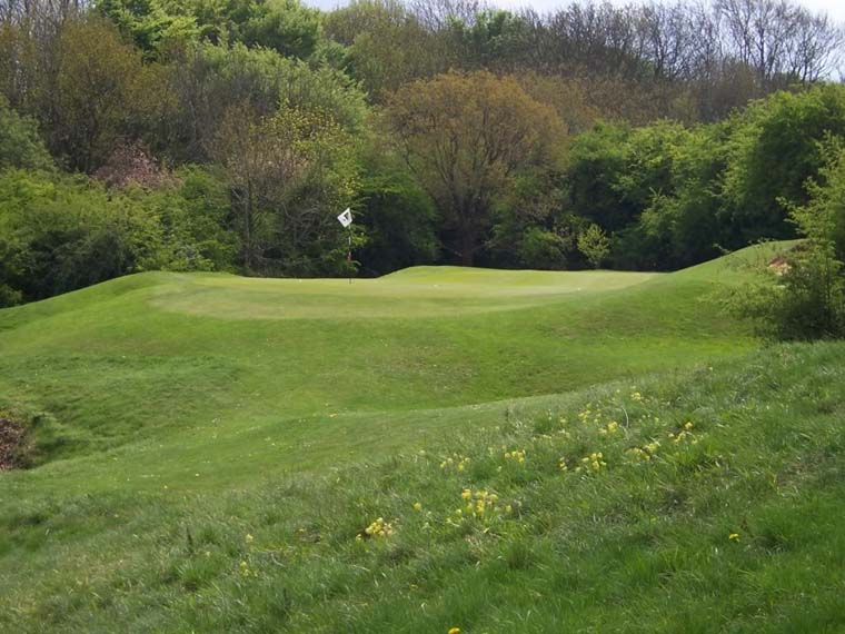 While the 128 yard 8th hole doesn't offer a terrific view, it does provide for a demanding tee shot. The hole plays a bit uphill to a narrow green with no room to miss left. The front flag doesn't look a particularly inviting target.